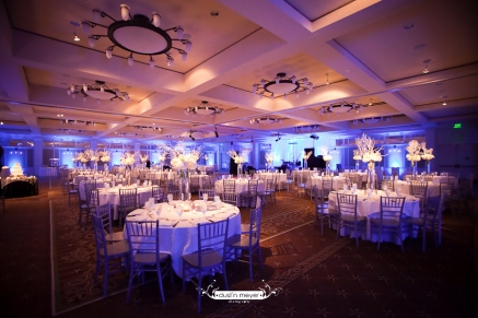 A wedding reception at Barton Creek Resort and Spa with linens, professional lighting, and floral designs.