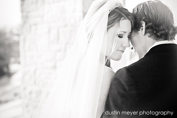 A black and white wedding photo of a bride and groom at Barton Creek Resort in Austin, TX.