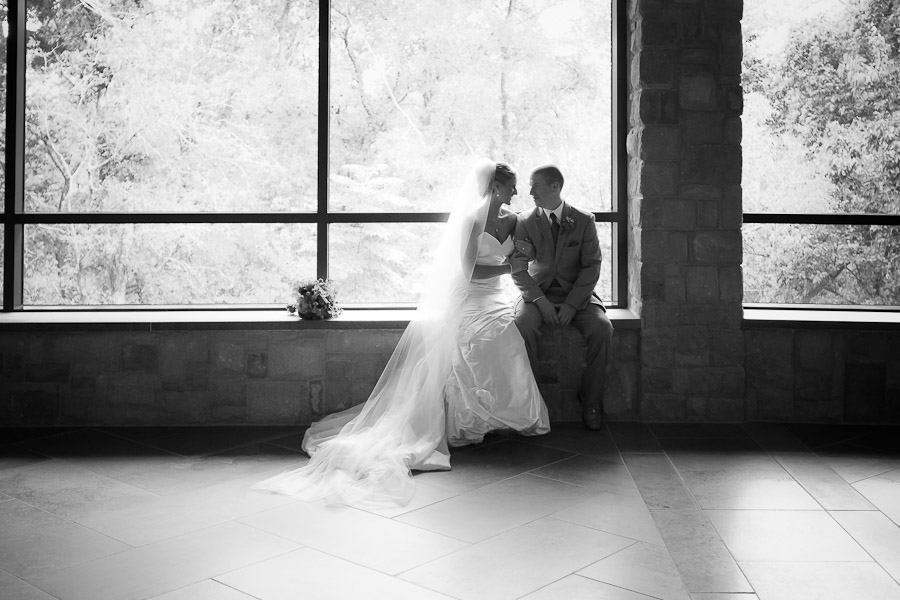 Austin wedding photographers by Dustin Meyer Photography capture this beautiful candid black and white wedding portrait at St. John Neuman Catholic Church in Westlake, TX.