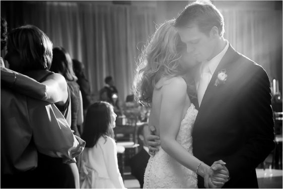 Gorgeous black and white shot of bride and groom slow dancing for their first dance at the wedding reception held Bob Bullock Texas State history Museum