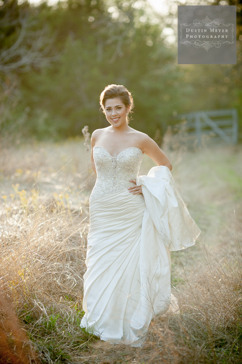 bridal portraits with a smile in front of old country gate