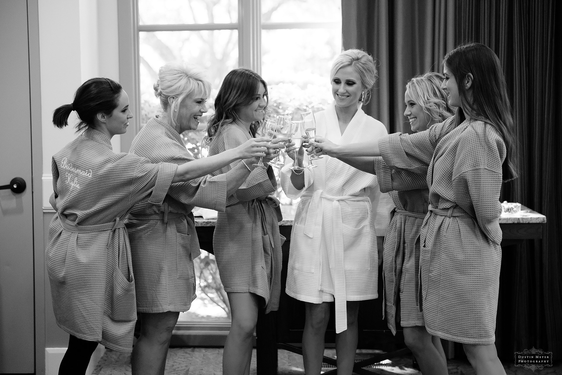black and white getting ready photo in the bridal suite with champagne toast