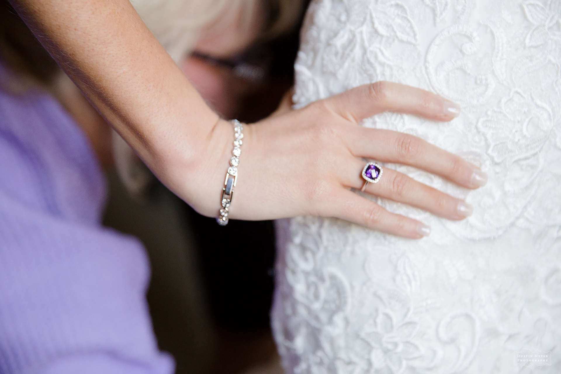 detail shot of bride's strapless lace bridal wedding gown