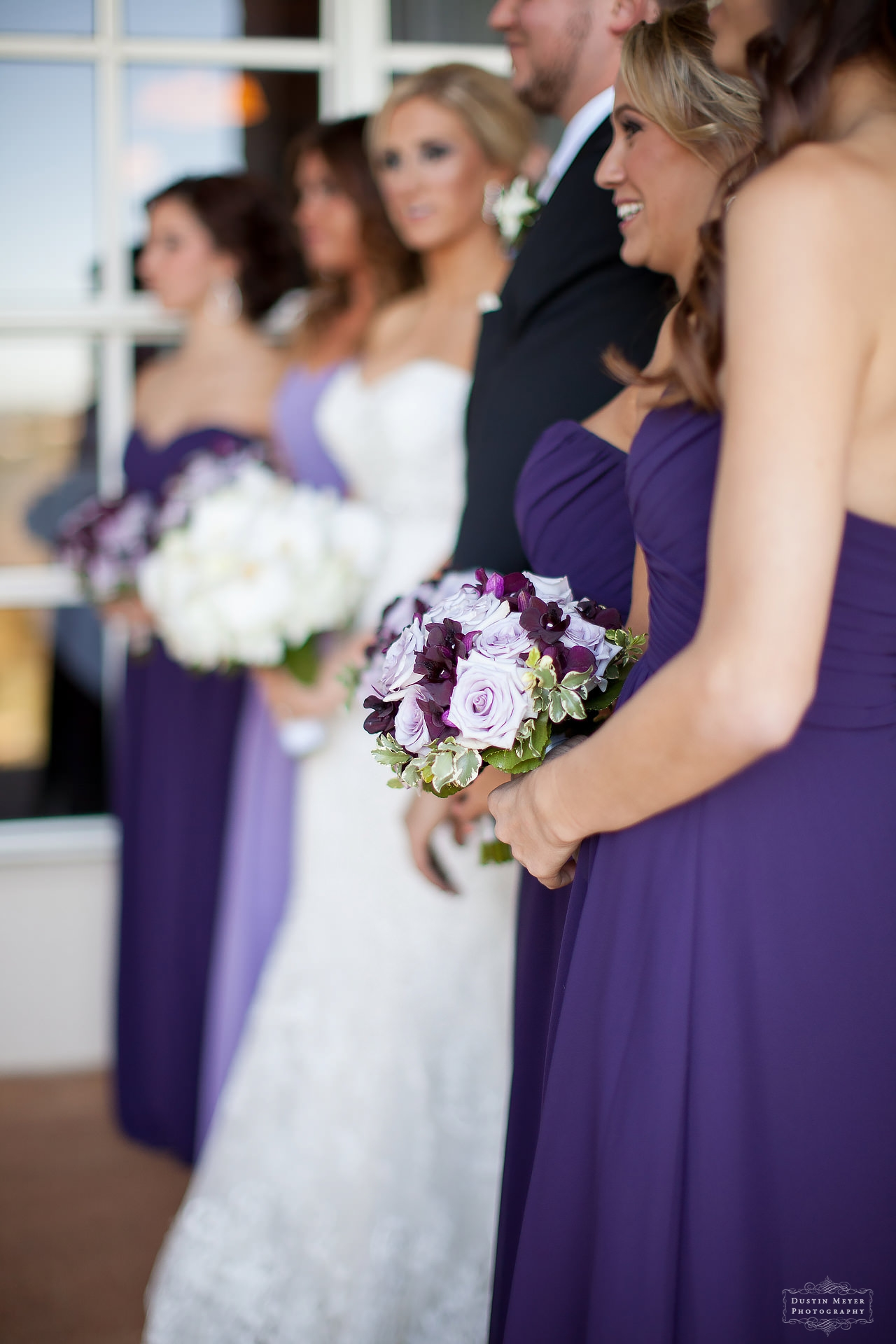 bridesmaids purple strapless wedding dresses gowns and bouquets