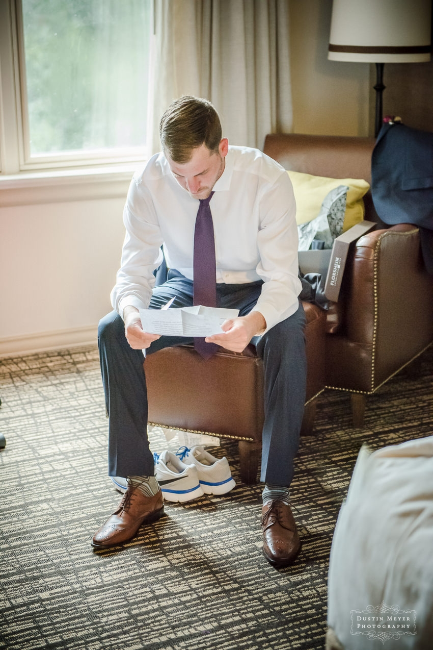 groom reading his wedding vows before the ceremony