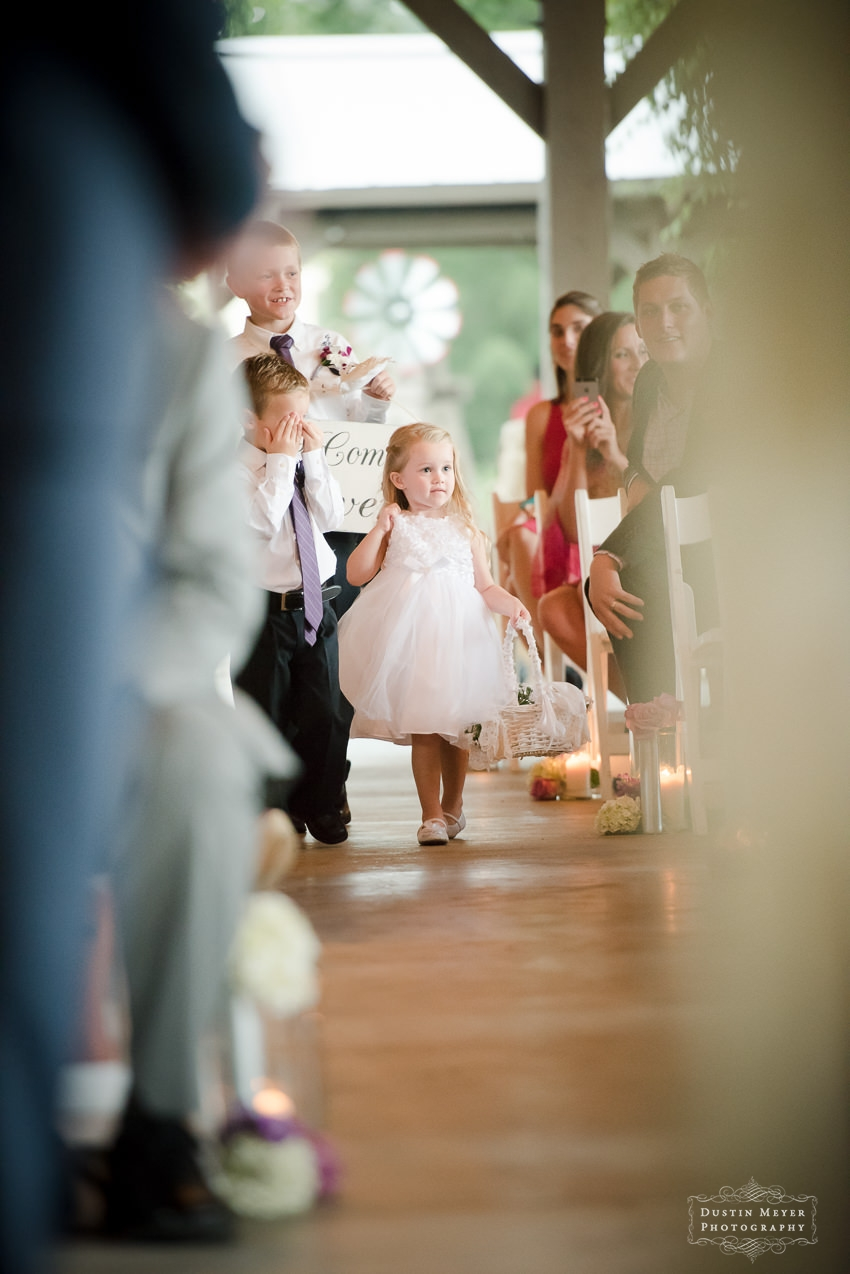 a flower girl walks down the aisle at a Hyatt Lost Pines Wedding