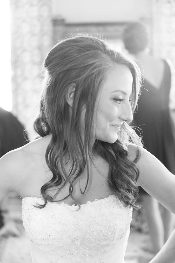 Dustin Meyer is the best wedding photographer in Austin black and white photo of a bride smiling in her bridal gown with a wedding hairstyle half up half down