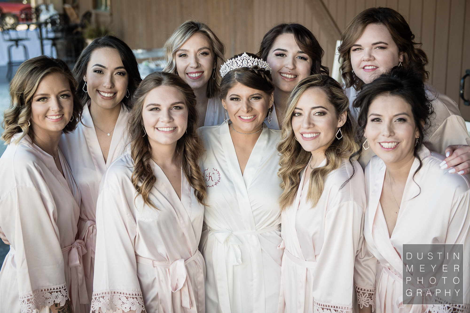 The bride and her bridesmaids in their matching wedding day robes