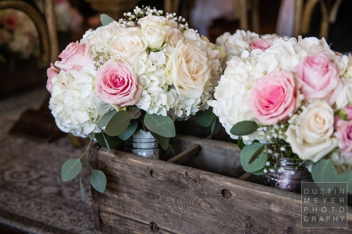A colorful bridal bouquet along with stunning floral designs throughout the wedding.