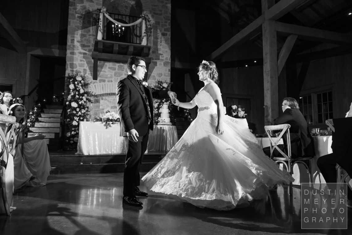 Black and white photo of the first dance of the bride and groom.