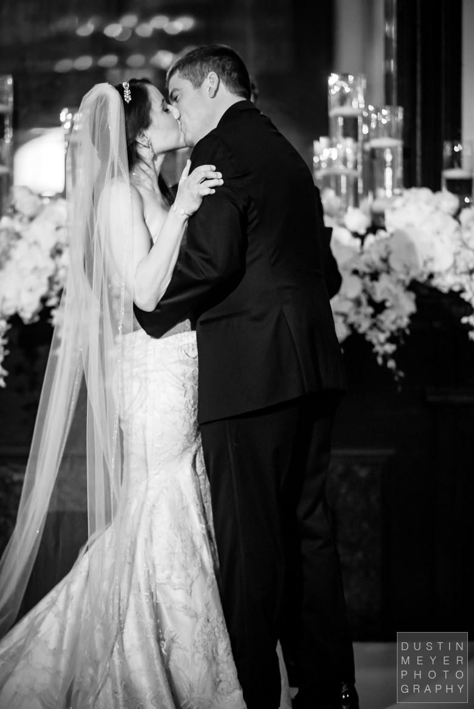 Bride and Groom Kiss at the altar | Driskill Hotel Wedding Austin Wedding Photographers